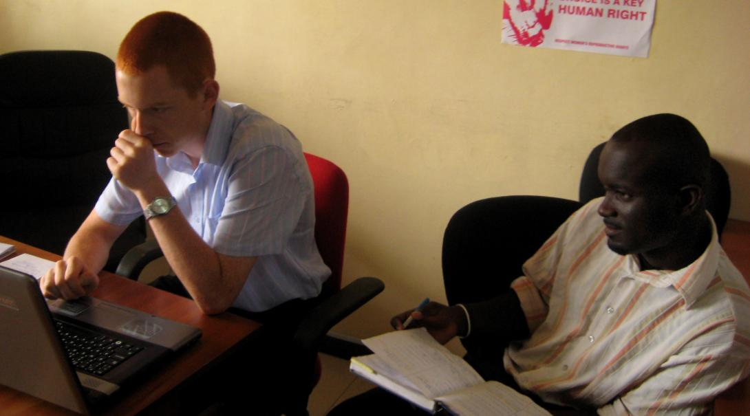 A volunteer helps a lawyer from Ghana with administrative work while doing his law internship with Projects Abroad.
